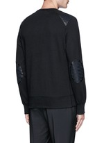 Perforated leather patch sweatshirt