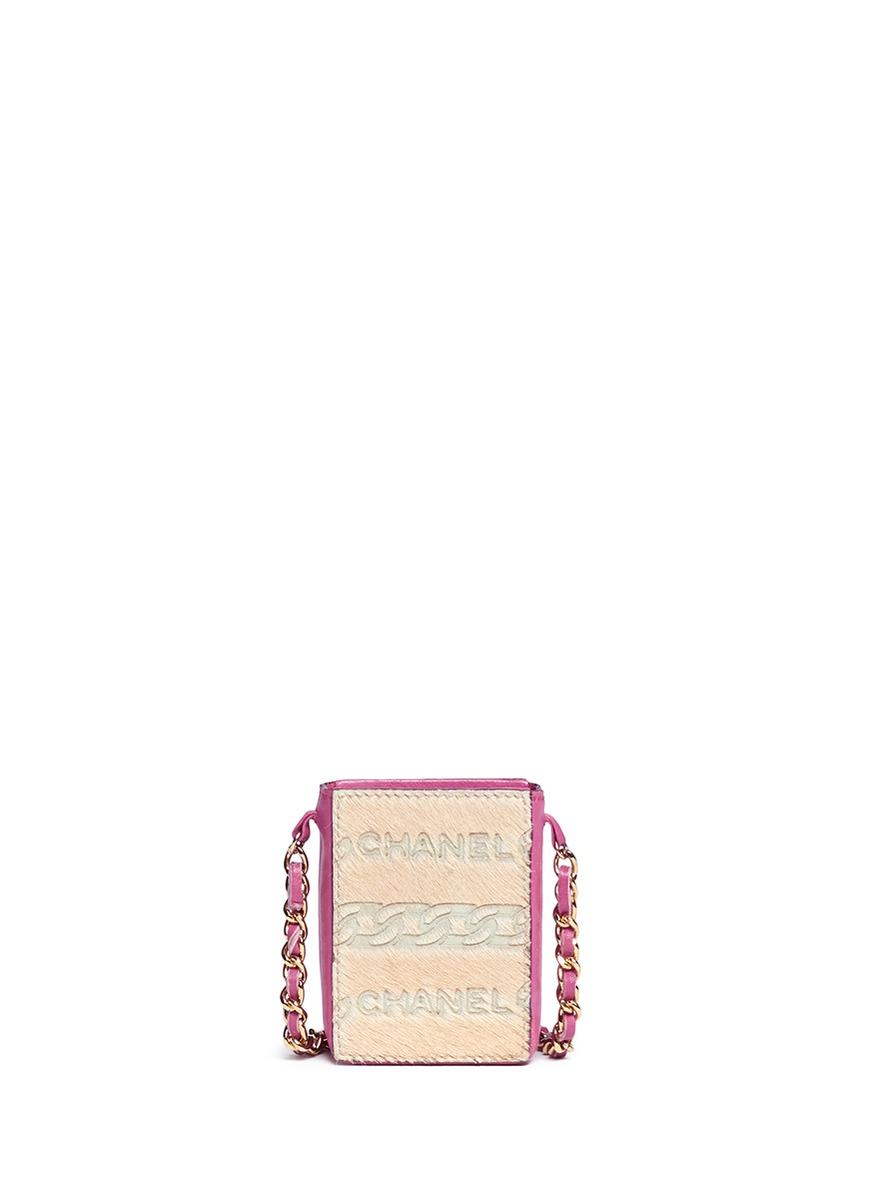 Embossed logo ponyhair mini handbag by Vintage Chanel