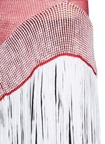 Asymmetric distressed mesh knit fringe top