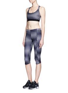 Ivy ParkKaleidostripe print performance capri leggings