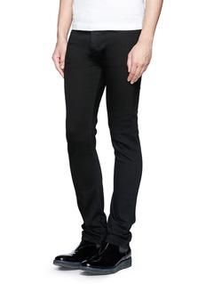 VALENTINO铆钉点缀修身牛仔裤