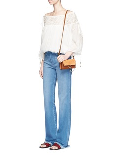 Chloé Frayed cuff denim pants