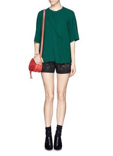 ALICE + OLIVIALaser cut leather shorts