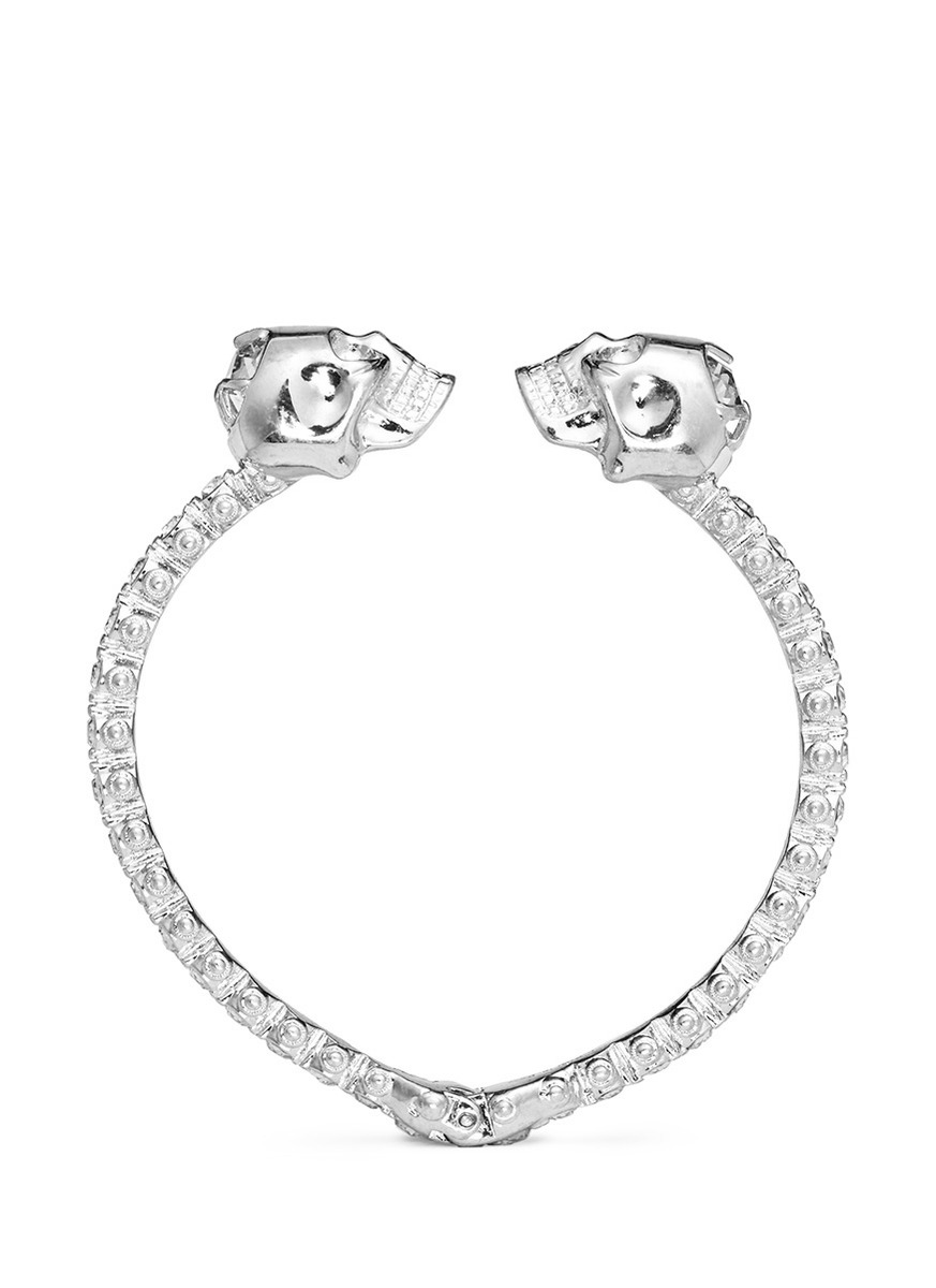 Double skull crystal bangle by Alexander McQueen