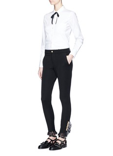 Gucci GG pearl ruffle lace zip cuff pants