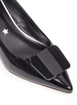 Enamel plaque patent leather pumps