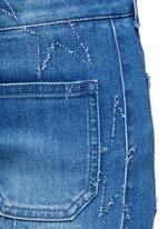 Distressed star kick flare denim pants