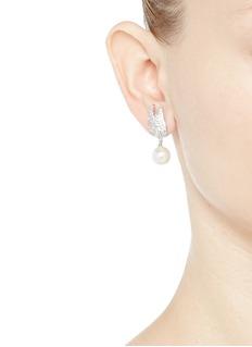 CZ by Kenneth Jay LaneFaux pearl drop cubic zirconia wing earrings
