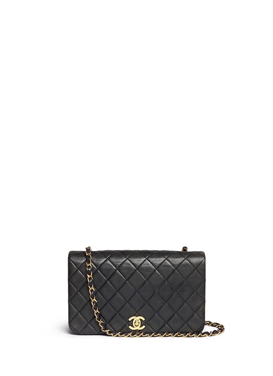 Quilted leather full flap bag by Vintage Chanel