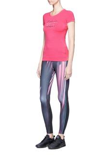 Calvin Klein CollectionMesh panel stripe print performance leggings