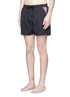 Insted We Smile 'Olson' swim shorts