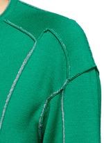 Asymmetric patchwork knit sweater