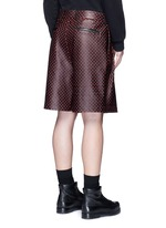 Cross perforated leather Bermuda shorts