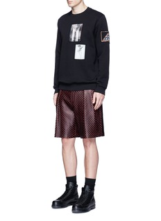 Givenchy Cross perforated leather Bermuda shorts