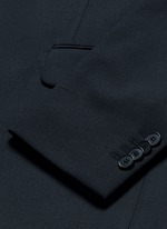 Notched lapel wool suit