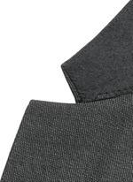 Notch lapel speckled wool suit