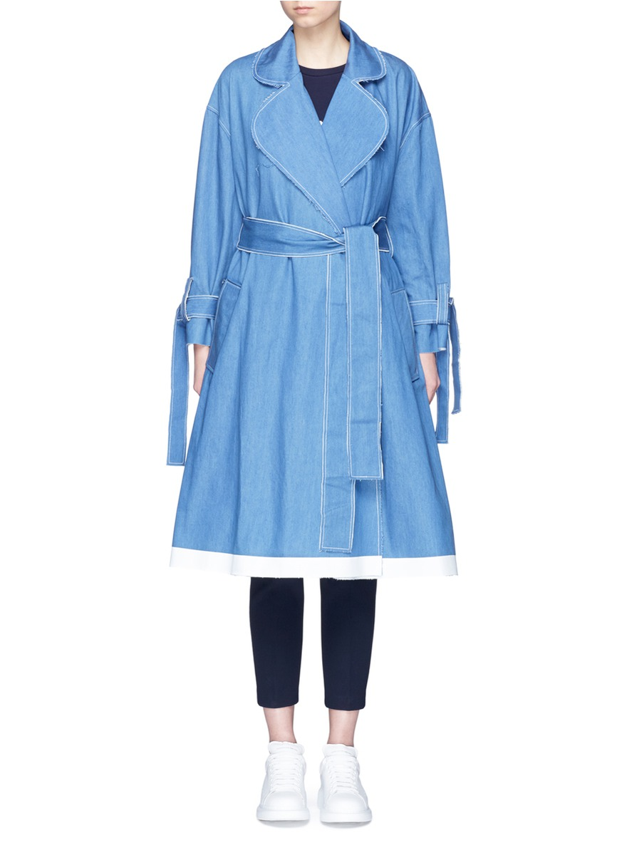 Frayed denim belted trench coat by Xiao Li