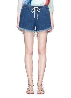 CHLOÉAcid wash frayed denim shorts
