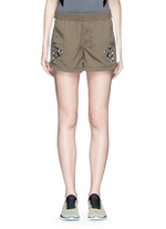 'The Cappella' flocked floral print running shorts