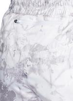 'White Palm' print drawstring running shorts