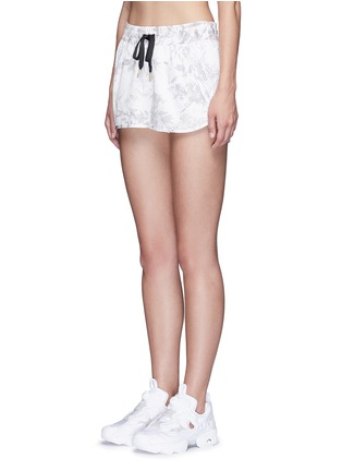 Front View - Click To Enlarge - Alala - 'White Palm' print drawstring running shorts