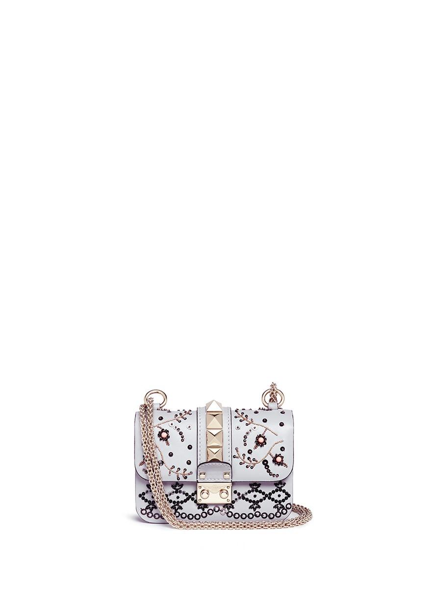 Rockstud Lock mini beaded leather chain bag by Valentino