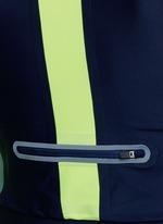 Arrow colourblock thumbhole sleeve cropped top