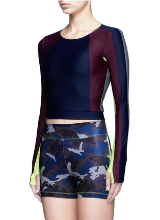 Front View - Click To Enlarge - Laain - Arrow colourblock thumbhole sleeve cropped top