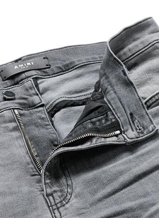 Amiri-Pleat leather repair slim fit jeans