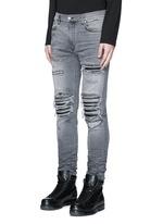 Pleat leather repair slim fit jeans