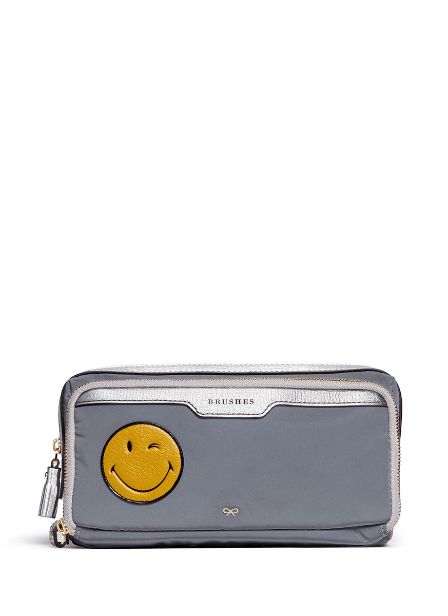 Wink small leather smiley reflective nylon zip pouch by Anya Hindmarch
