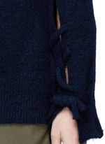 Knotted back wool blend sweater