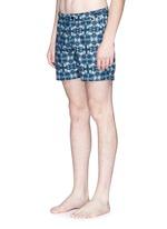 Photographic floral print swim shorts