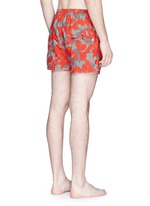 Floral camouflage print elastic swim shorts