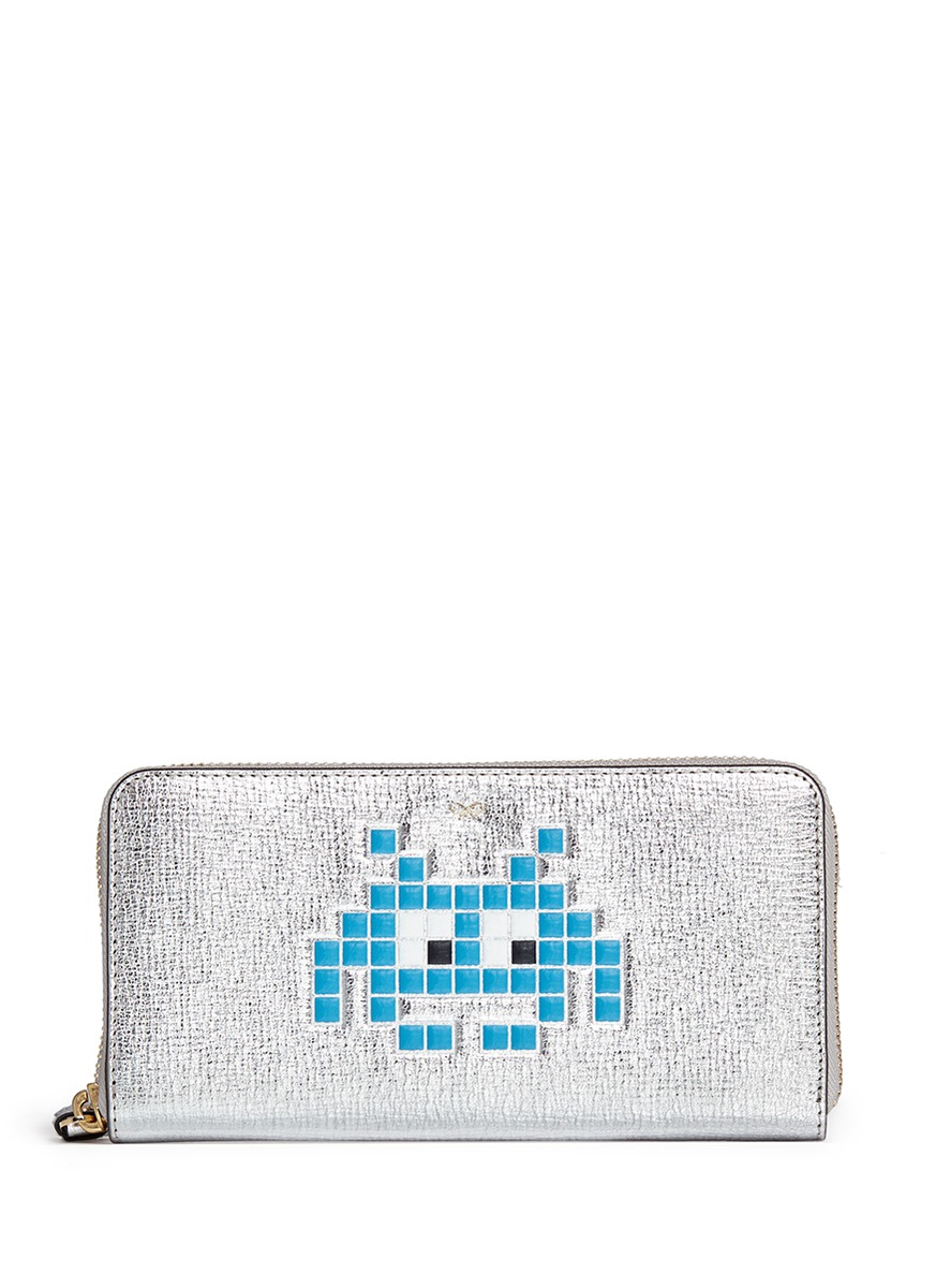 Space Invaders embossed metallic leather continental wallet by Anya Hindmarch