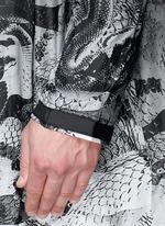'Camu' snake print nylon poncho