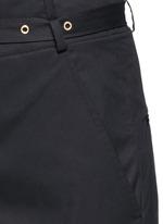 Metal grommet belt cropped pants