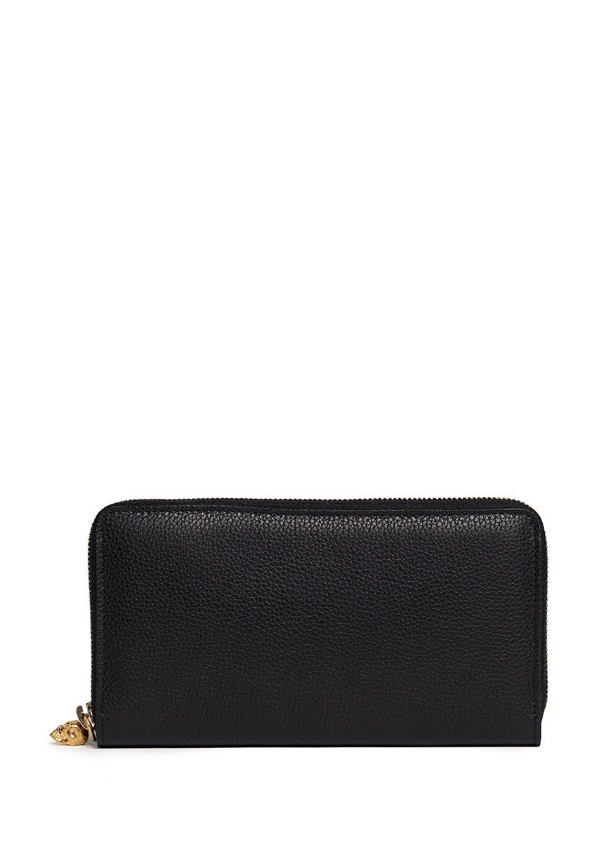 Skull charm leather continental wallet by Alexander McQueen