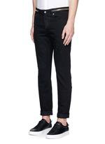Zip waist distressed slim fit jeans
