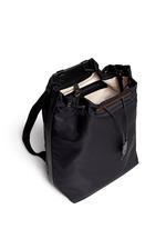 Leather trim nylon drawstring backpack