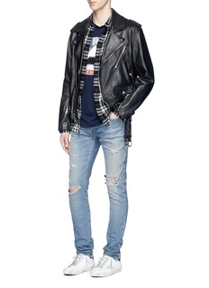 Saint LaurentLow rise distressed skinny jeans