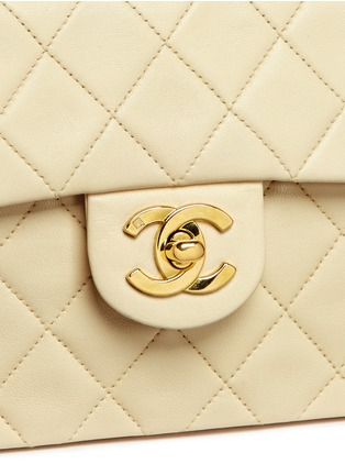 - Vintage Chanel - Mini quilted lambskin leather flap bag