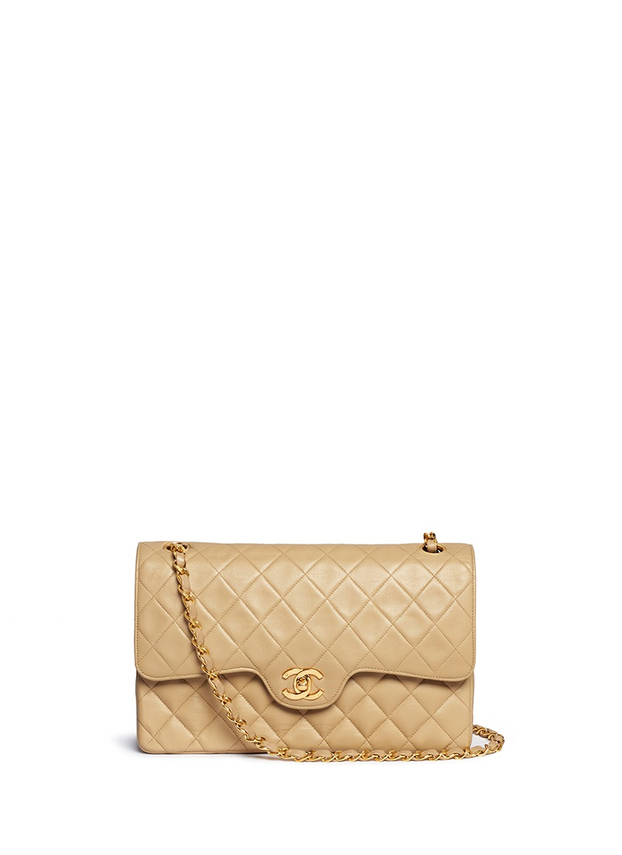 Quilted leather lambskin leather 10″ flap bag by Vintage Chanel
