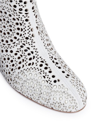 Detail View - Click To Enlarge - Alaïa - Geometric lasercut perforated suede ankle boots