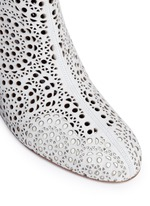Geometric lasercut perforated suede ankle boots