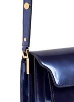 'Trunk' mini acccordion patent leather flap bag