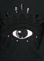 Beaded eye embroidery sweatshirt