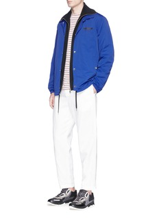 KENZO'Come Out' slogan embroidered track jacket