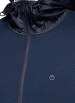 Tech fabric sleeve and hood blouson jacket