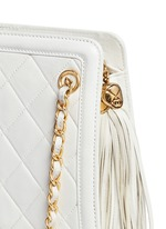Tassel charm quilted leather bag